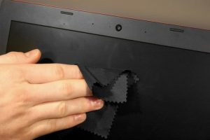 use a microfiber cloth or a dry eraser while cleaning screen